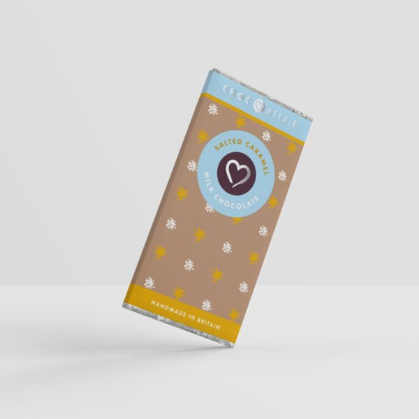 A salted caramel flavoured milk chocolate bar on one corner as if pivoting against a white background