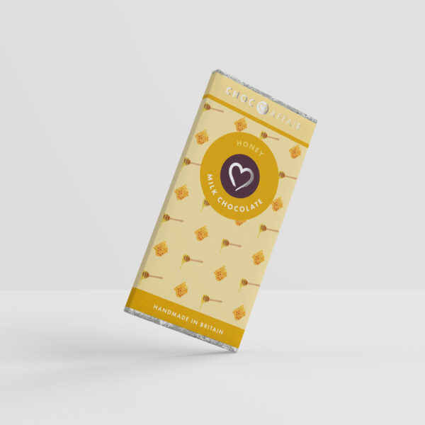 A honey milk chocolate bar against a white background
