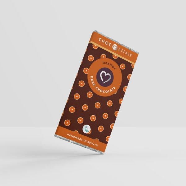 A 90 gram Orange dark vegan chocolate bar