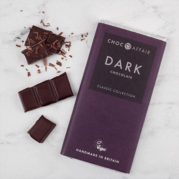 Classic dark chocolate bar on worktop