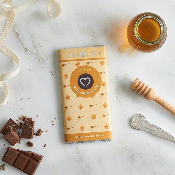 Honey milk chocolate bar on worktop