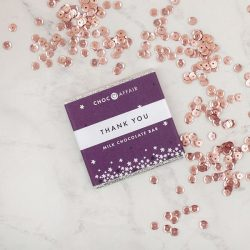 Milk chocolate thank you mini bar with sequins on worktop