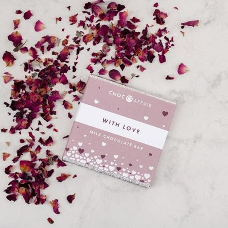 Milk chocolate 'with love' mini bar with rose petals on worktop