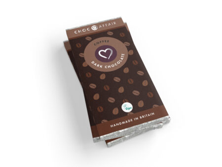 A single vegan registered coffee dark chocolate bar pivoting against a white background