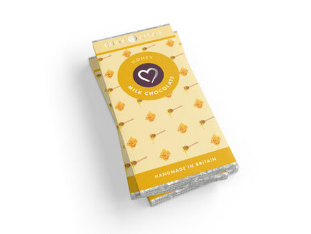 A stack of honey flavour milk chocolate bars on a white background