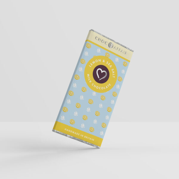 A Lemon and sea salt flavoured milk chocolate bar on one corner as if pivoting against a white background