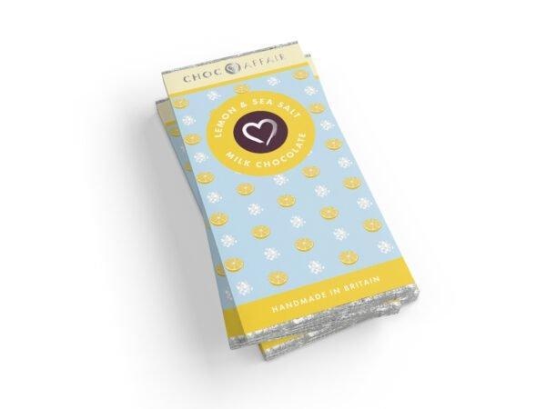 A stack of lemon & sea salt chocolate bars on a white background