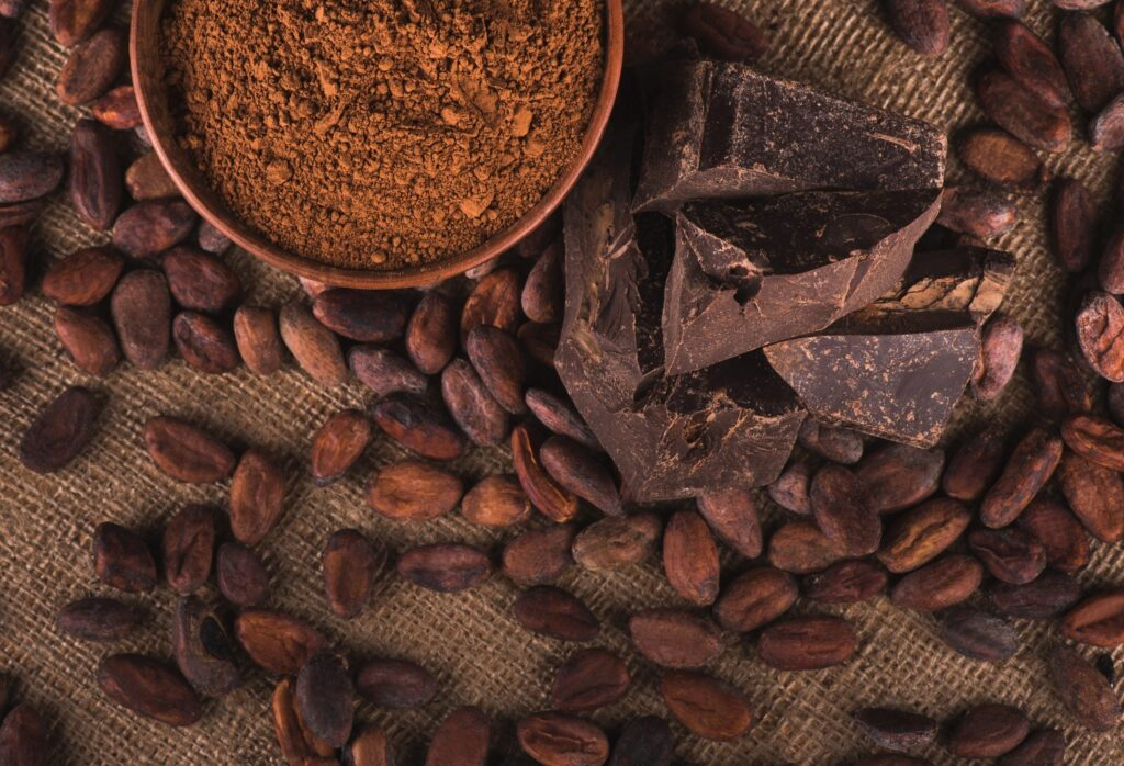 dark chocolate and cocoa beans on a twine cloth