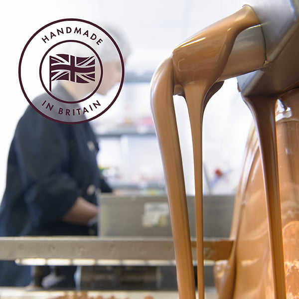 We handmake all of our chocolate in Britiain. Picture shows a member of the team handmaking chocolate