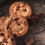 Four chocolate chip cookies on a wooden table